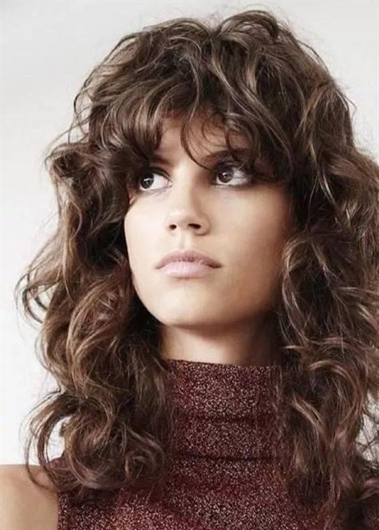 Стрижка для длинных кудрявых волос фото